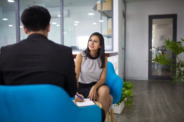 Portrait of smiling hr manager having interview with candidate Free Photo