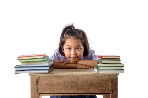 Portrait of smiling little student asian girl with many books Premium Photo