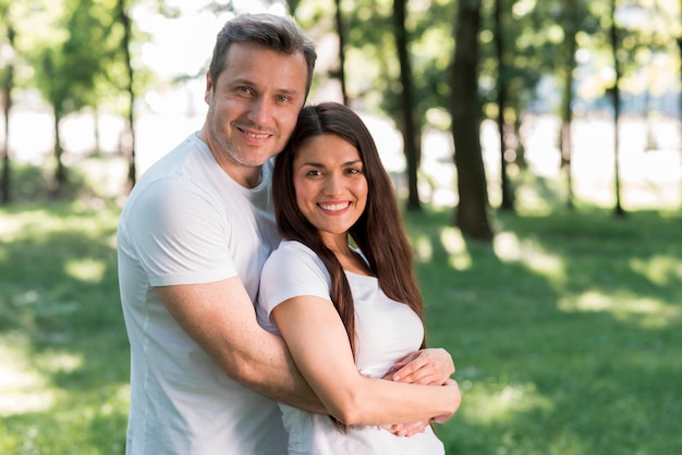 Portrait of smiling loving couple in park Free Photo