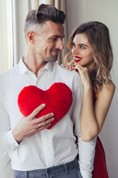 Portrait of a smiling loving smart dressed couple Free Photo