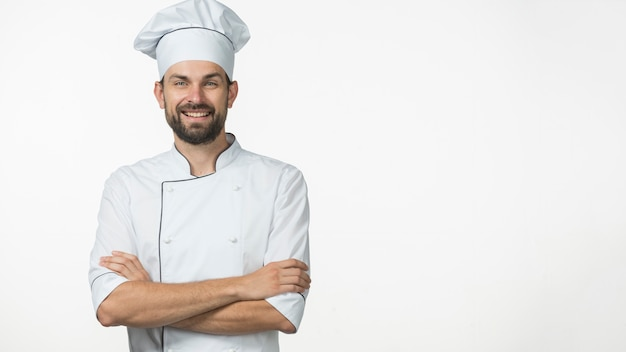 Portrait of smiling male chef in white uniform isolated over white background Premium Photo