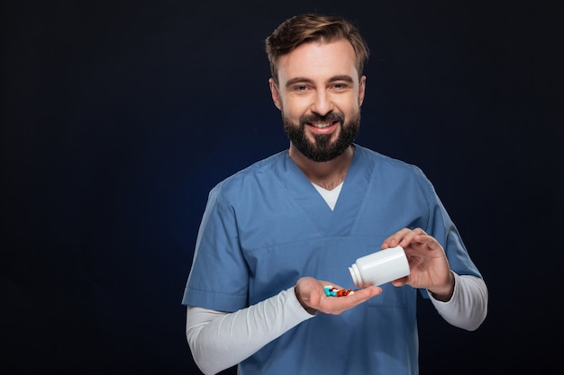 Portrait of a smiling male doctor dressed in uniform Free Photo