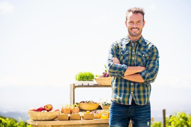 Portrait of smiling man standing at farm Premium Photo