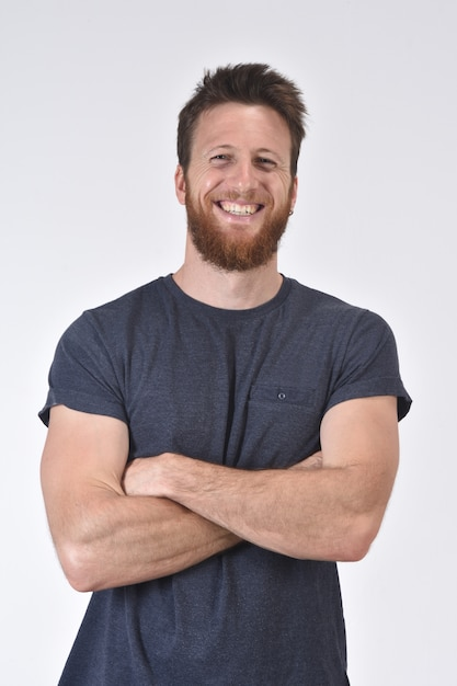 Portrait of a smiling man with  arms crossed on white Premium Photo