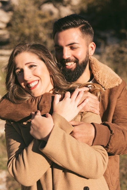 Portrait of smiling man and woman hugging Free Photo