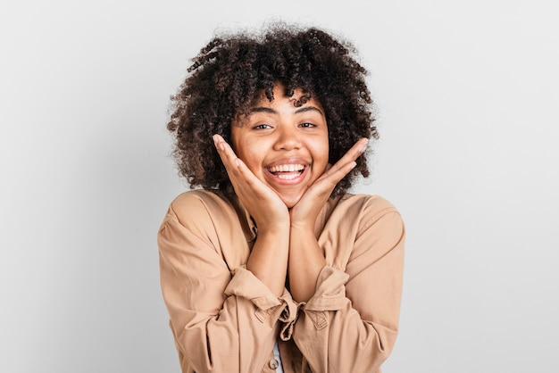 Portrait of smiling woman putting hand around her face Free Photo