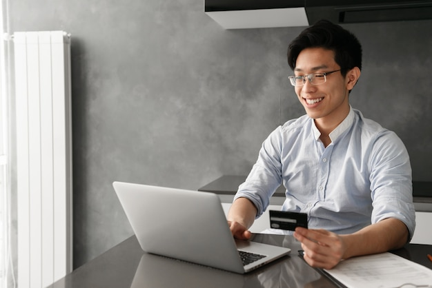 Portrait of a smiling young asian man Premium Photo