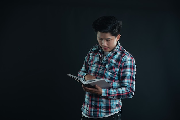 Portrait of smiling young college student with books Free Photo