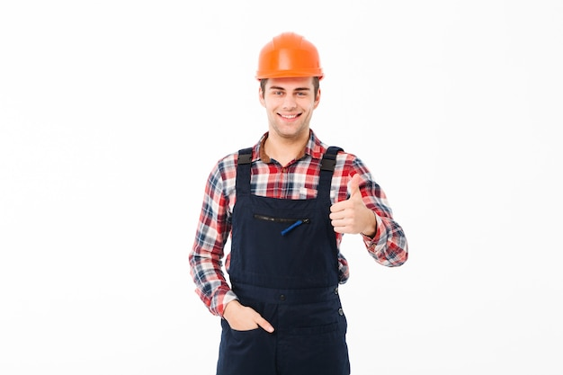 Portrait of a smiling young male builder Free Photo