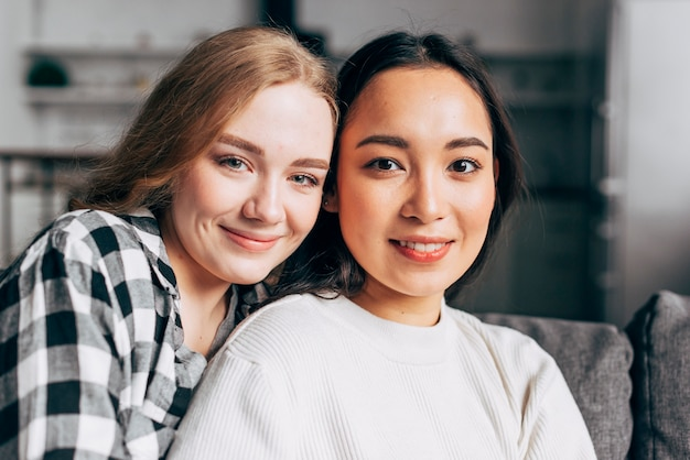 Portrait of smiling young women at home Free Photo