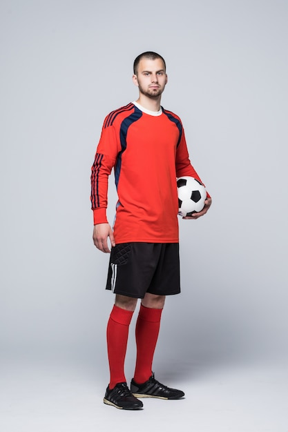 Portrait of soccer player in red shirt isolated on white Free Photo