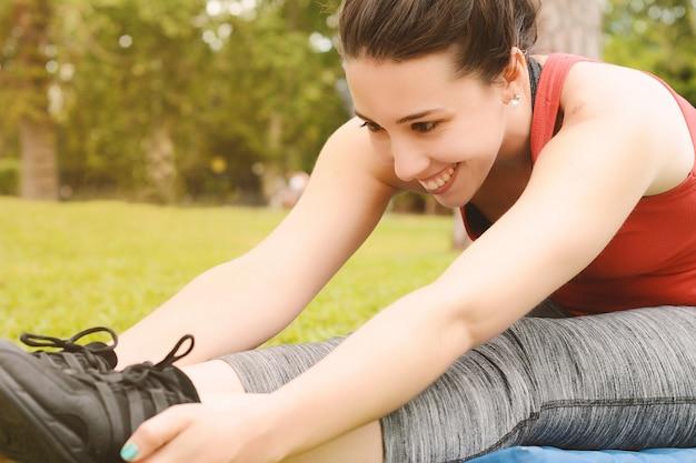 Portrait of sport woman streching legs Premium Photo