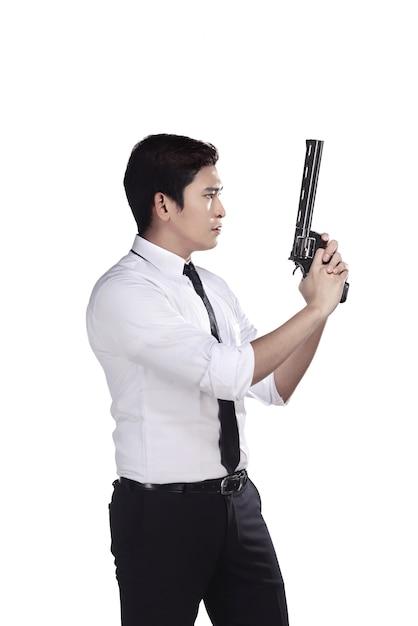 Portrait of srcret agent holding a gun Premium Photo