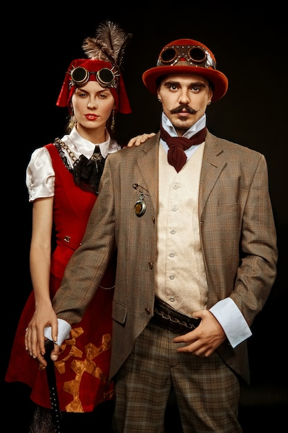 Portrait of steampunk girl and man in glasses and cane Premium Photo