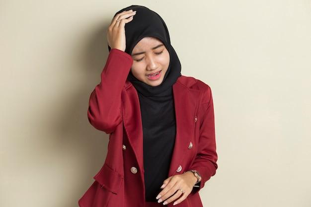 Portrait of stressed sick muslim woman with headache ill woman suffers from vertigo, dizziness, migraine, hangover, health care concept young adult asian woman model Premium Photo