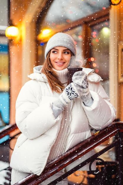 Portrait of stunning girl walking on the holiday city Premium Photo