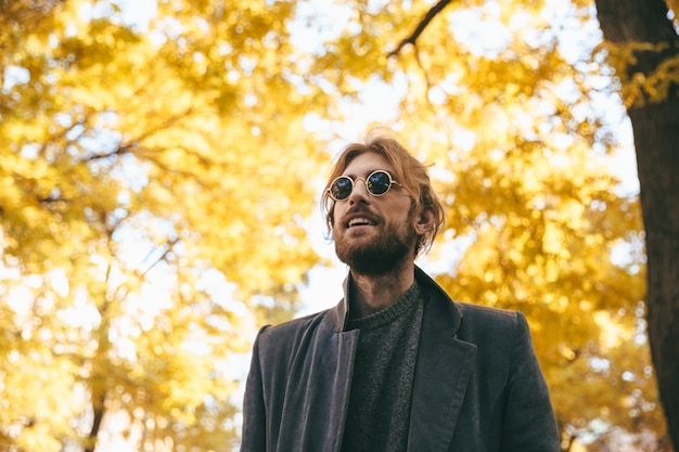Portrait of a stylish bearded man in sunglasses Free Photo