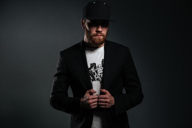 Portrait of a stylish bearded man wearing jacket and sunglasses Free Photo