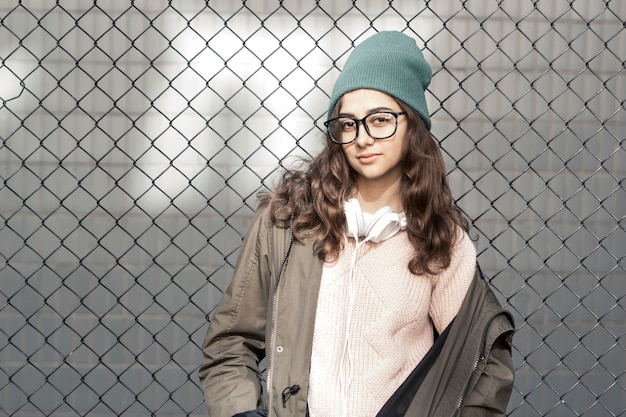 4780552c61e Portrait of a stylish teenager hipster girl in a hat. young fashionable  woman in glasses Premium Photo
