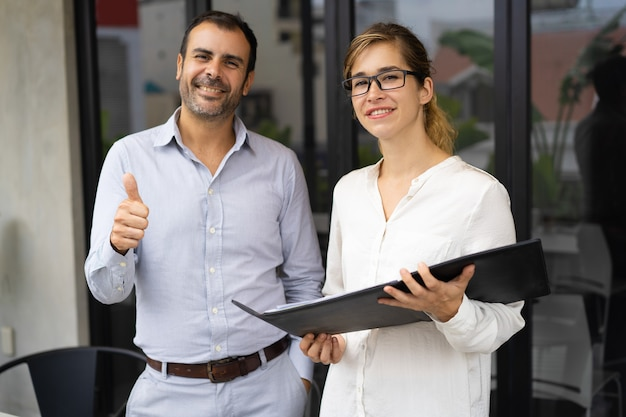 Portrait of successful team of young woman and mid adult man Free Photo