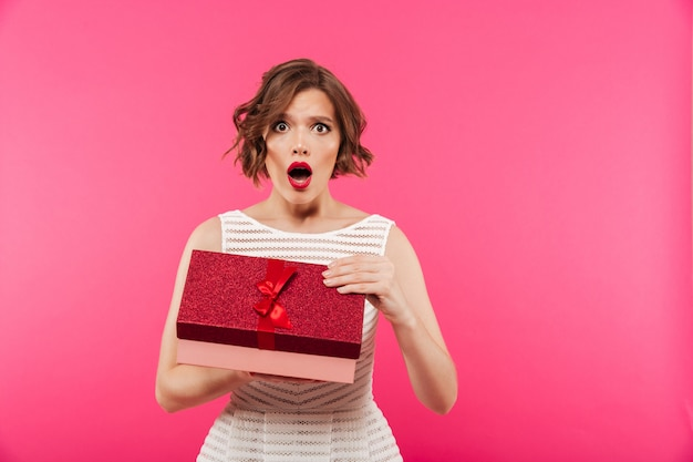 Portrait of a surprised girl dressed in dress Free Photo