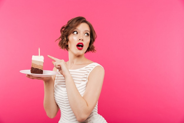 Portrait of a surprised girl holding plate Free Photo