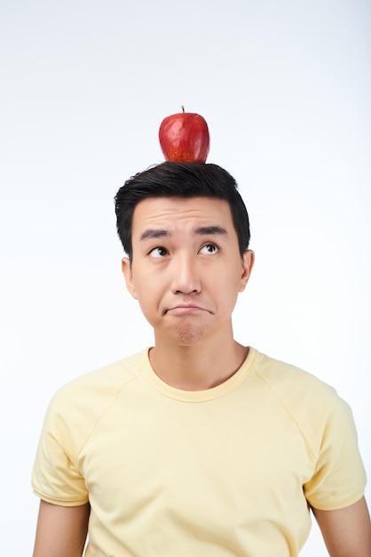 Portrait of thoughtful asian man Free Photo