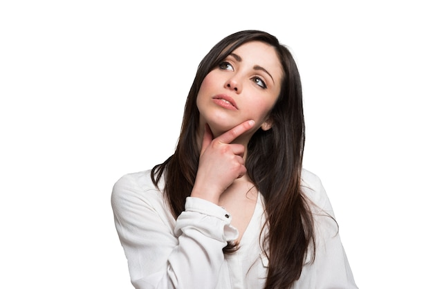 Portrait of a thoughtful young woman Premium Photo