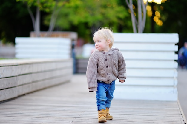 Portrait of toddler boy walking in a big city Premium Photo