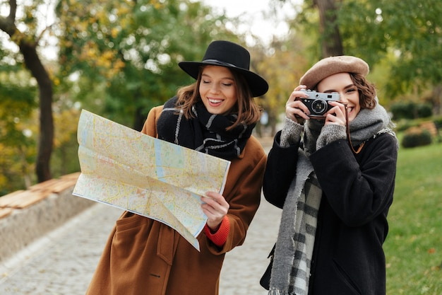 Portrait of two attractive girls dressed in autumn clothes Free Photo