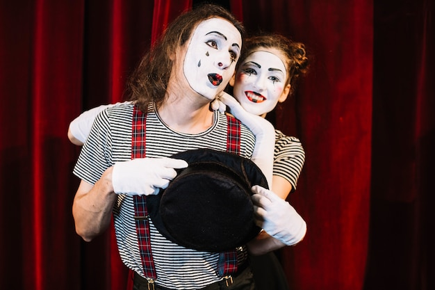 Portrait of two lovely mime artist performer Free Photo