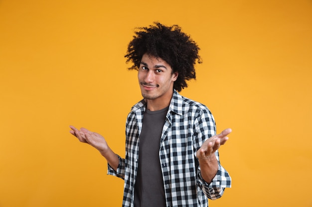 Portrait of an unconfident young afro american man Free Photo