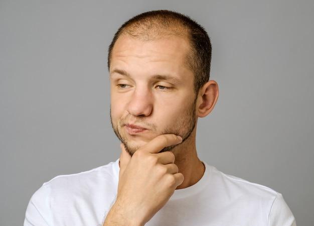 Portrait of unhappy handsome guy with beard Premium Photo