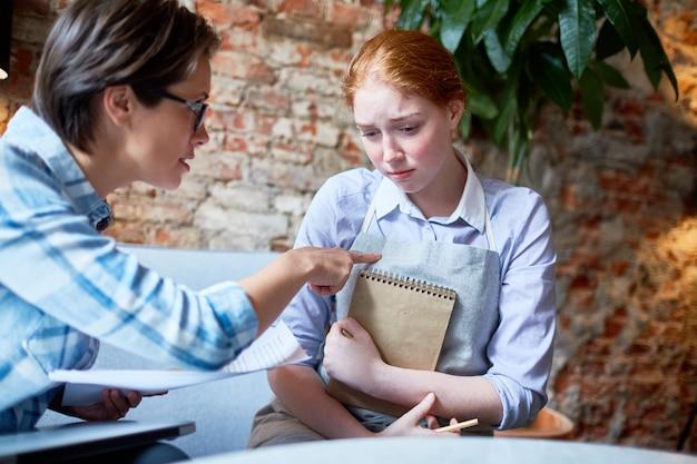 Portrait of upset waitress Free Photo