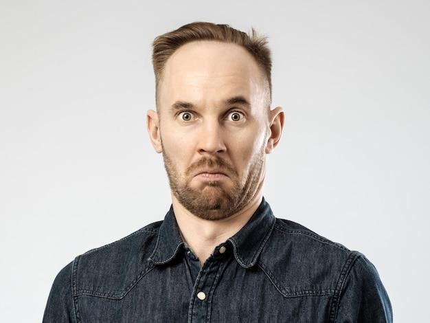 Portrait of upset young man Premium Photo