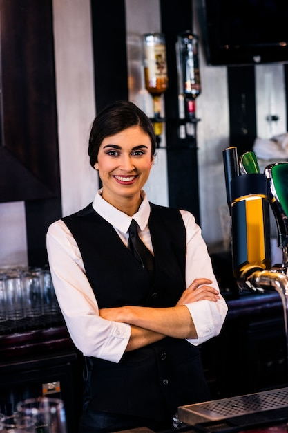 Portrait of waitress behind the counter in a bar Premium Photo