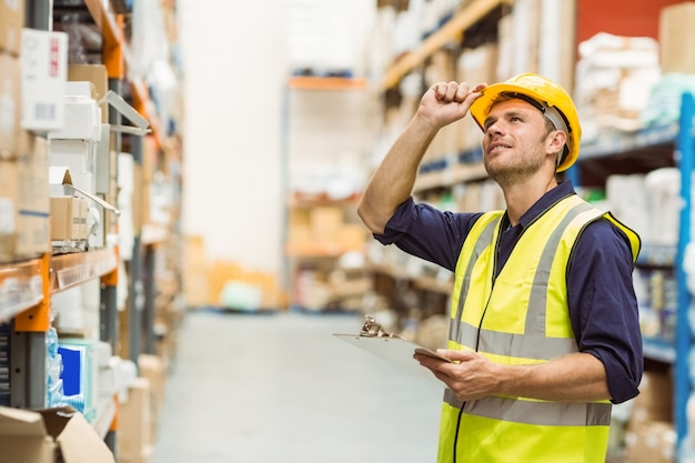 Portrait Of Warehouse Worker With Clipboard Photo