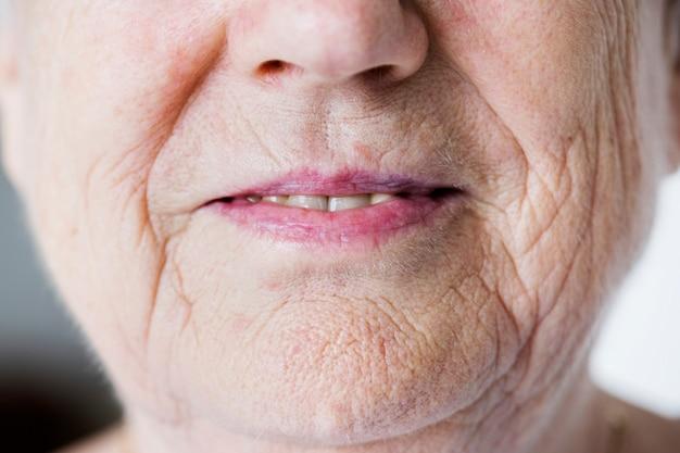 Portrait of white elderly woman closeup on smiling lips Free Photo