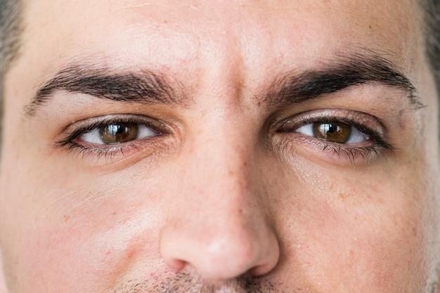 Portrait of white man closeup on eyes Free Photo