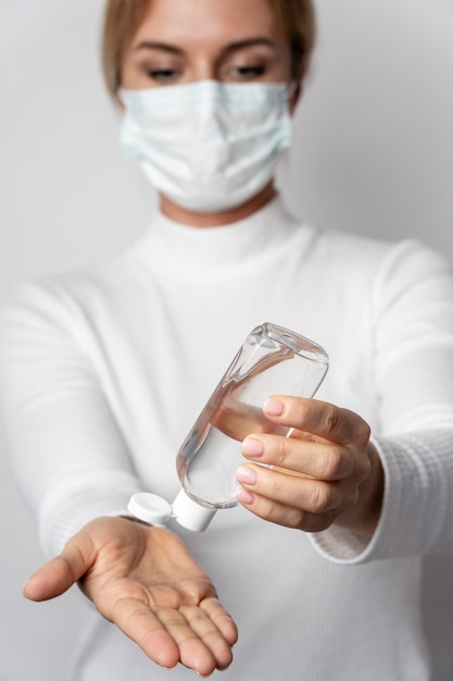 Portrait of woman applying washing gel for hands Free Photo