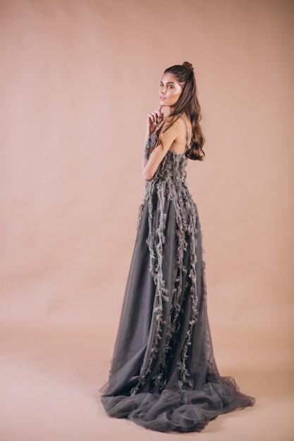 Portrait of woman in beautiful grey dress Free Photo