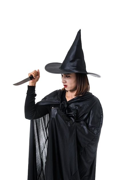 Portrait of woman in black scary witch halloween costume standing with hat standing isolat Premium Photo