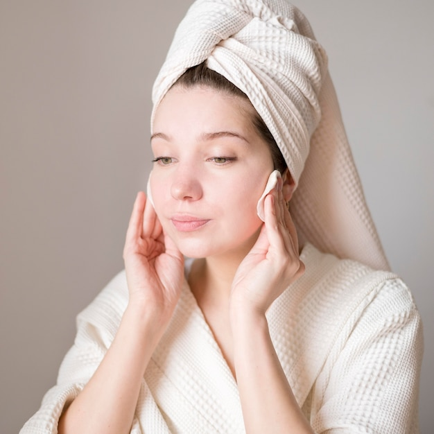 Portrait woman cleaning face Free Photo
