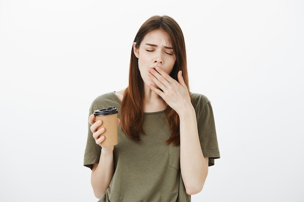 Portrait of a woman in a dark green tshirt Free Photo