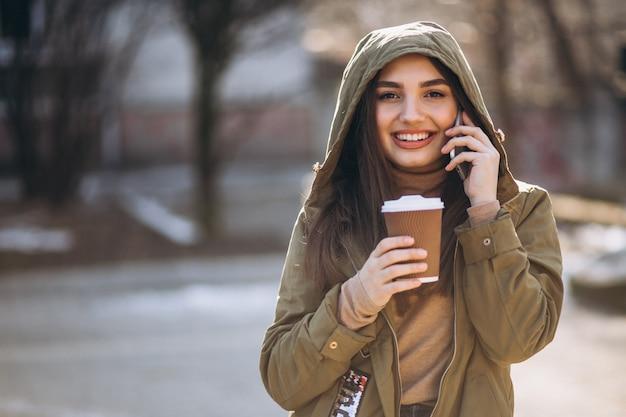 Portrait of woman drinking coffee Free Photo