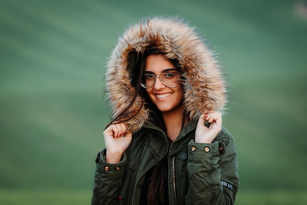Portrait of a woman feeling cold in winter on green meadow Premium Photo