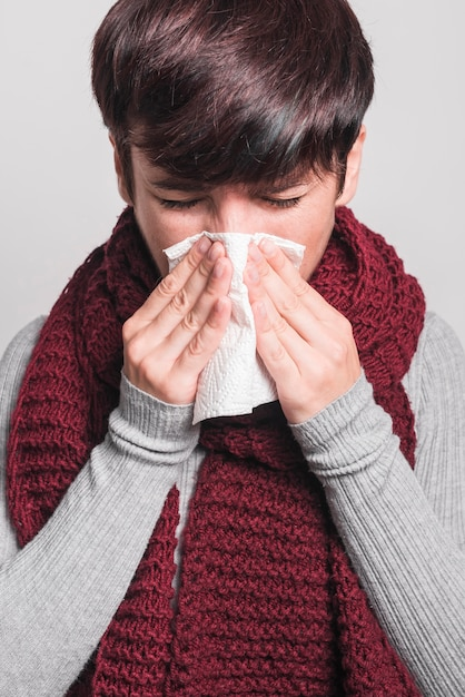 Portrait of woman having cold and cough Free Photo