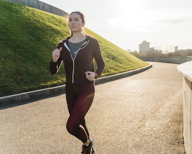 Portrait of woman jogging in the nature Free Photo