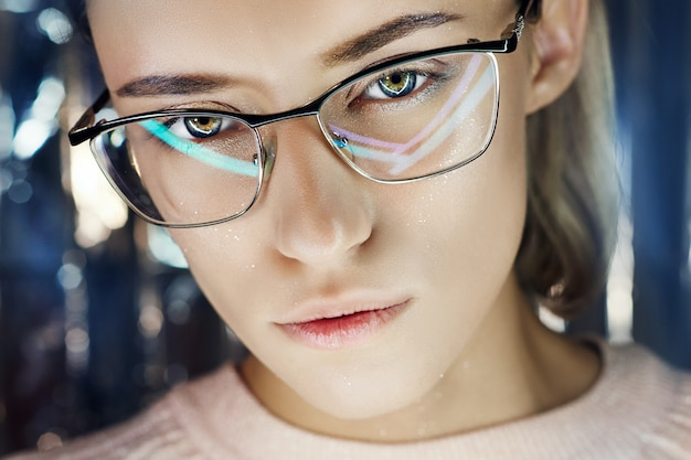 Portrait woman in neon colored reflection glasses Premium Photo