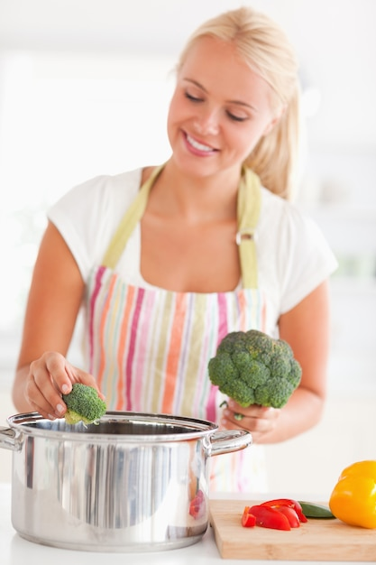 Portrait of a woman putting cabbage on water Premium Photo